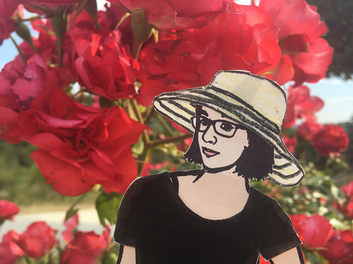 paper doll of the artist with pink flowers
