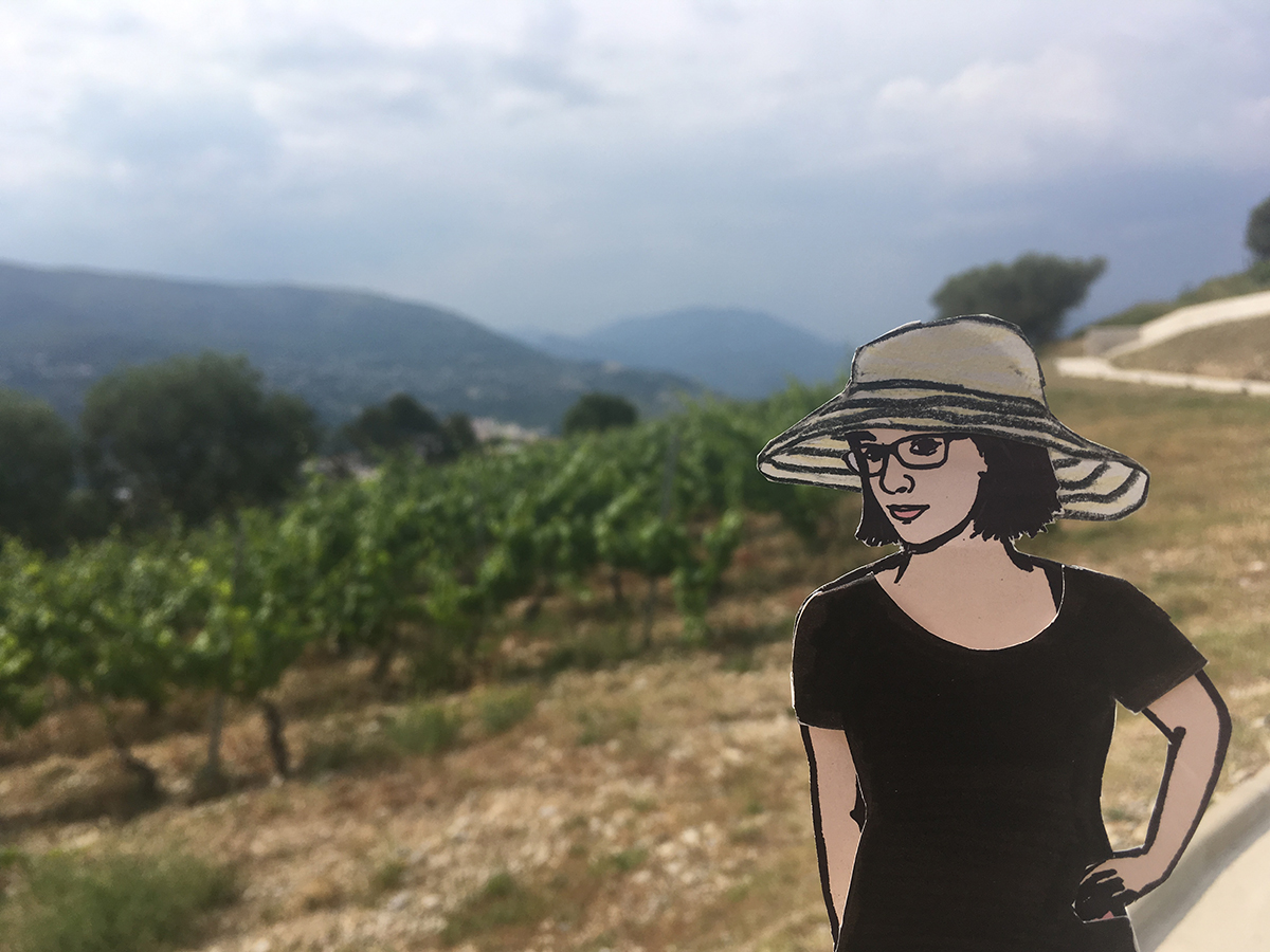 paper doll of the artist with grape plants