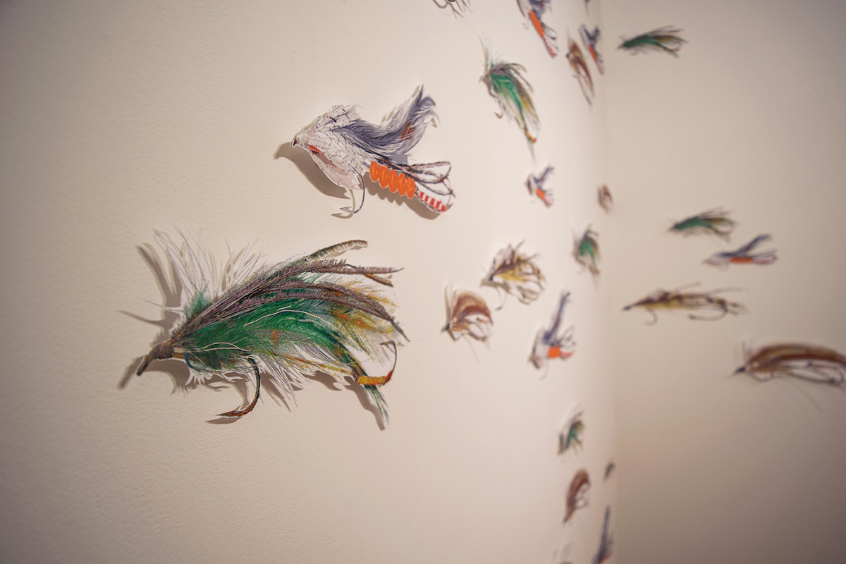 "17"" long digital illustrations of fishing lures, cut out and mounted on the wall"