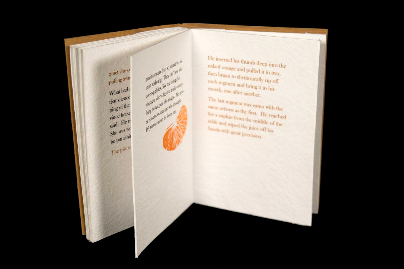 inside of book, with black and sepia text and small orange segment print