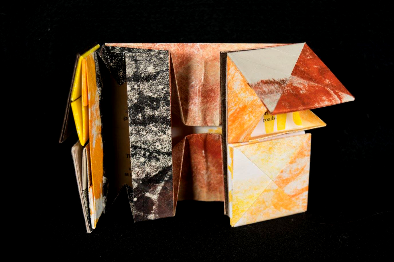 """inside of """"the lucky leaf"""" artist book, where poem stanzas are tucked inside a series of folded paper boxes"""