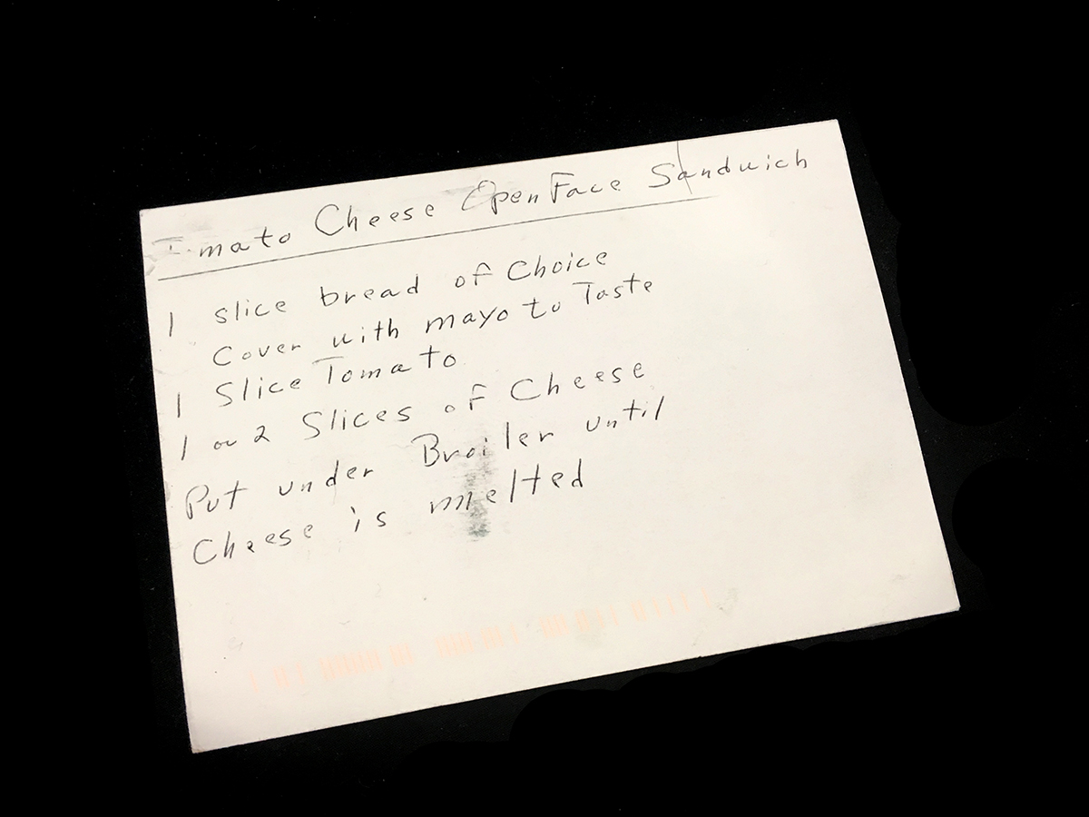 "opposite side of postcard with handwritten recipe ""Tomato Cheese Open Face Sandwich: 1 slice bread of choice, cover with mayo, 1 slice tomato, 1 or 2 slices of cheese, put under broiler until cheese is melted."""