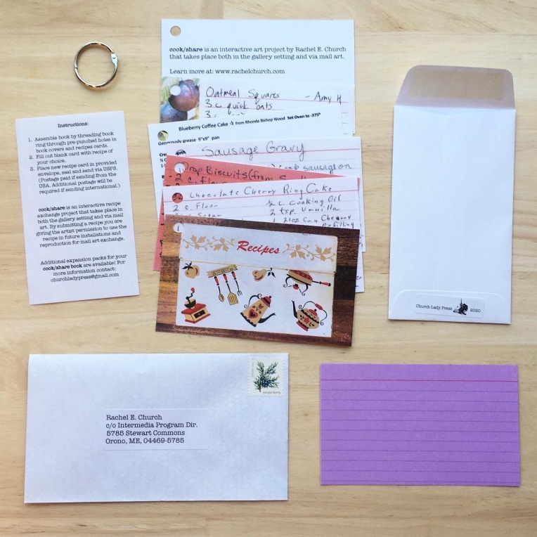 """5 recipe card with hole punched in top left corner. 1 front cover with hold punch in top left corner showing image of recipe box. 1 back cover with hole punch in top left corner. 1 small piece of paper with instructions. 1 book ring. 1 blank recipe card. 1 postage-paid addressed envelope. One small open envelope which reads """"Church Lady Press. 2020."""""""