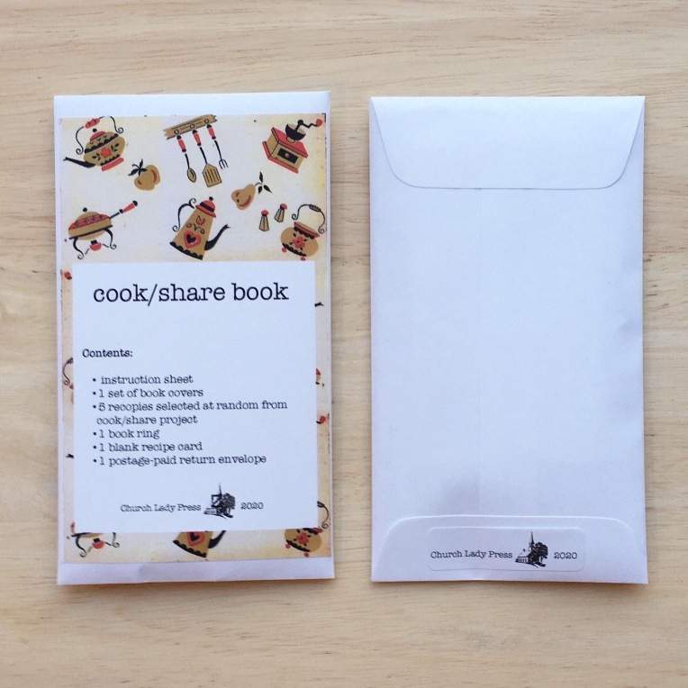 """front and back view of a small envelope. Front reads """"cook/share book. Contents: 1 instruction sheet, 2 covers, 5 recipe cards at random for cook/share projects, 1 book ring, 1 blank recipe card, 1 postage-paid addressed envelope."""" Back reads """"Church Lady Press. 2020."""""""