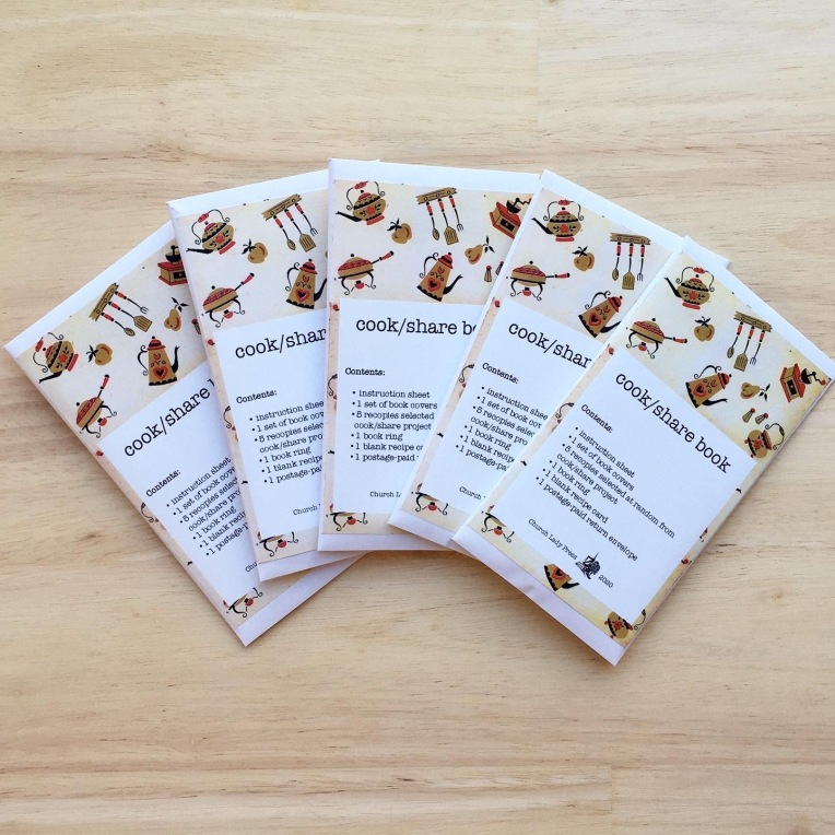 """5 cook/share books: each reads """"cook/share book. Contents: 1 instruction sheet, 2 covers, 5 recipe cards at random for cook/share projects, 1 book ring, 1 blank recipe card, 1 postage-paid addressed envelope."""""""