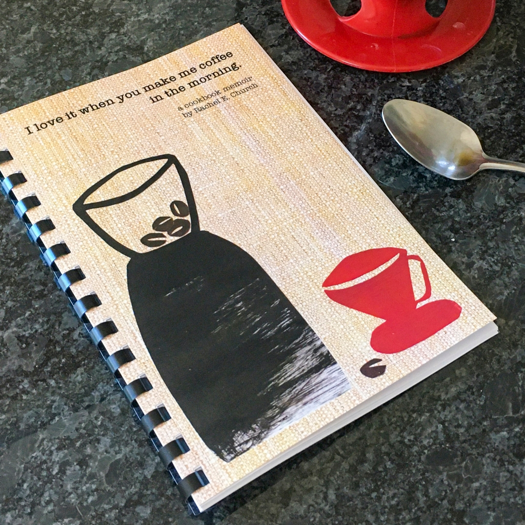 cookbook on countertop with spoon and coffee brewer