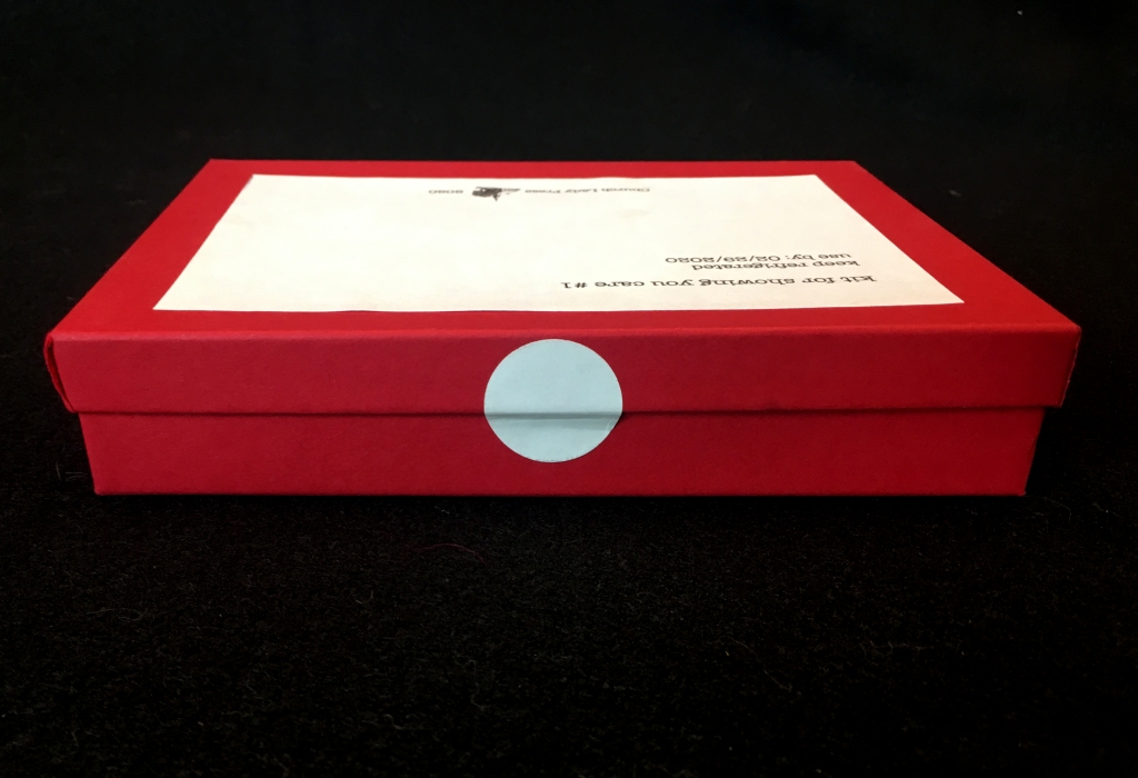 side view of box with round sticker seal