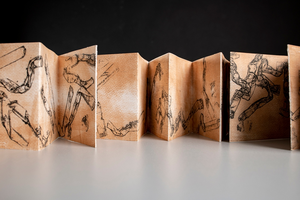 accordion book with straw wrapper collograph prints